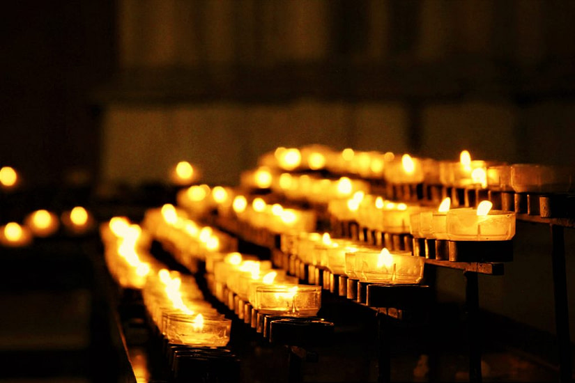Lighting a candle at Cologne Cathedral, Travel guide to Germany