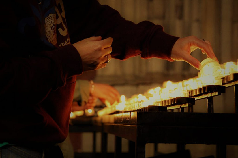 Lighting a candle in the cathedral in Cologne Germany