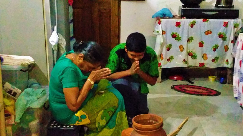 Praying over the stove facing the correct direction during Sinhala New Year
