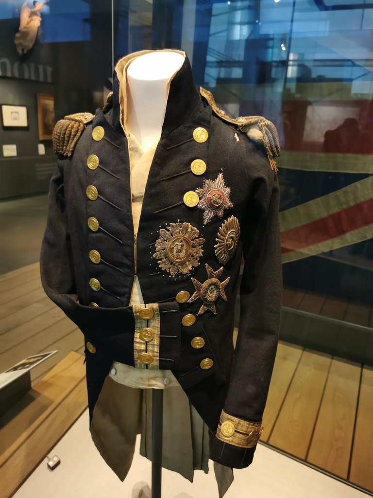 Nelsons jacket, the bullet hole can be seen on the left shoulder