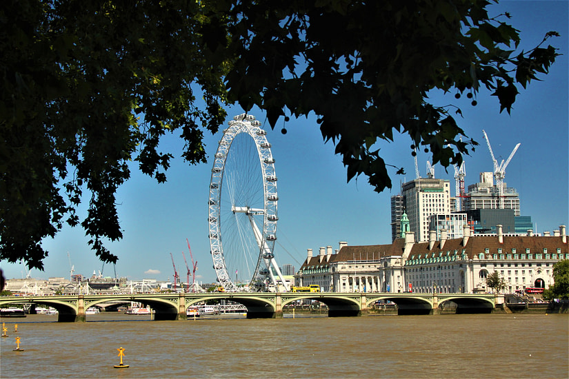 Views along the River Thames, with the London Eye in the distance